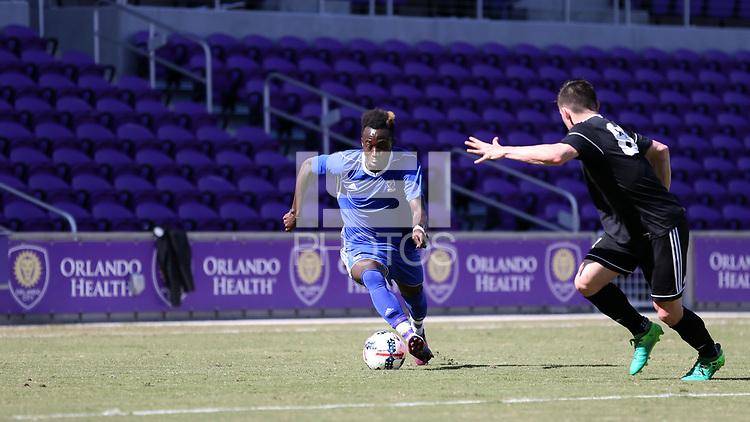 Orlando, Florida - Wednesday January 17, 2018: Edward Opoku and Lucas Stauffer. Match Day 3 of the 2018 adidas MLS Player Combine was held Orlando City Stadium.