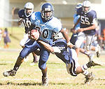 The Gazette Central's Gordon Crossland runs through Largo's Mohamed Conteh's tackle during the first half of Largo's homecoming game on Saturday afternoon at Largo.