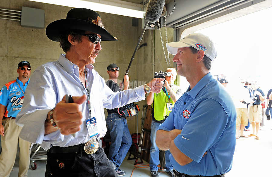 May 24, 2009; Indianapolis, IN, USA; IRL driver John Andretti (right) talks with team owner Richard Petty in the garage prior to the 93rd running of the Indianapolis 500 at Indianapolis Motor Speedway.  Mandatory Credit: Mark J. Rebilas-