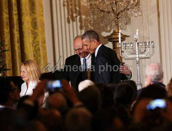 The grand-daughter and son of Shimon Peres, Mika Almog (L) and Chemi Peres (C) leave the stage with US President Barack Obama (R) at the end of the second Hanukkah reception of the day in the East Room of the White House, December 14, 2016, Washington, DC. Photo Credit: Aude Guerrucci/CNP/AdMedia
