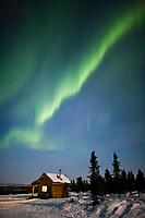 Aurora Borealis over Moose Creek cabin in the White Mountains National Recreation Area, Interior, Alaska.