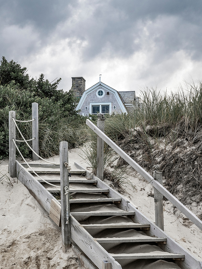 Beach house during pending storm, Cape Cod, Massachusetts, USA.