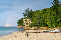 A colorful rainbow over Chapel Rock along the Pictured Rocks National Lakeshore. Munising, MI