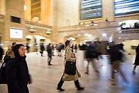 "NEW YORK, NEW YORK - MARCH 5: A woman wears a facial mask while walking fast in Grand Central Terminal at train rush hour on March 5, 2020. in New York City. The state of New York has 44 people in quarantine, about 4,000 people are in ""precautionary"" quarantine in more than two dozen counties, including more than 2,700 in the city and 1,000 in Westchester, Cuomo said. (Photo by Pablo Monsalve / VIEWpress via Getty Images)"