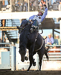 Richmond Champion competes in the bareback bronc riding event at the Reno Rodeo in Reno, Nev., on Thursday, June 27, 2013.<br /> Photo by Cathleen Allison
