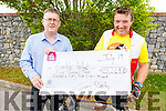 Sean Scally of Enable Ireland (Kerry Branch) accepts the sum of €5,249.10 from Tommy Sheehy on Tuesday, who did a Spinathon Fundraiser.