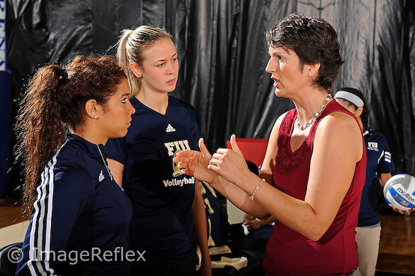 11 September 2011:  FIU Volleyball Head Coach Danijela Tomic (right) speaks with Assistant Coach Ines Medved (center) and Student Assistant Coach Natalia Valentin (left) prior to the match.  The FIU Golden Panthers defeated the Florida A&M University Rattlers, 3-0 (25-10, 25-23, 26-24), at U.S Century Bank Arena in Miami, Florida.