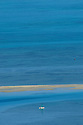 Pirogue sailing at L'ile aux Benitier near Le Morne in Mauritius.