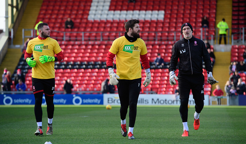 Lincoln City's Grant Smith, left, Lincoln City's Josh Vickers and Lincoln City's first team goalkeeping coach Andy Warrington during the pre-match warm-up<br /> <br /> Photographer Chris Vaughan/CameraSport<br /> <br /> The EFL Sky Bet League Two - Lincoln City v Northampton Town - Saturday 9th February 2019 - Sincil Bank - Lincoln<br /> <br /> World Copyright © 2019 CameraSport. All rights reserved. 43 Linden Ave. Countesthorpe. Leicester. England. LE8 5PG - Tel: +44 (0) 116 277 4147 - admin@camerasport.com - www.camerasport.com