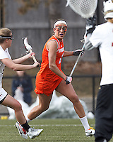 Syracuse University attacker Alyssa Murray (1) looks to center the ball.  Syracuse University (orange) defeated Boston College (white), 17-12, on the Newton Campus Lacrosse Field at Boston College, on March 27, 2013.