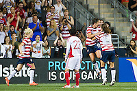 Abby Wambach (20) of the United States (USA) celebrates scoring with teammates. The United States (USA) women defeated China PR (CHN) 4-1 during an international friendly at PPL Park in Chester, PA, on May 27, 2012.