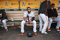 OAKLAND, CA - JUNE 29:  Denard Span #2 of the San Francisco Giants sits in the dugout before the game against the Oakland Athletics at the Oakland Coliseum on Wednesday, June 29, 2016 in Oakland, California. Photo by Brad Mangin