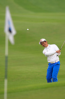 Liang Wen-chong (CHN) chips onto the 1st green during Thursday's Round 1 of the 2014 BMW Masters held at Lake Malaren, Shanghai, China 30th October 2014.<br /> Picture: Eoin Clarke www.golffile.ie