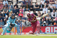 Andre Russell (West Indies) goes down the wicket and launches Adil Rashid (England) for six during England vs West Indies, ICC World Cup Cricket at the Hampshire Bowl on 14th June 2019