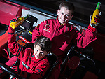 © Joel Goodman - 07973 332324 . 4 August 2013 . Daytona Manchester, Unit 4 Circle South, Wharfside Way, Trafford Park, Manchester M17 1NF , UK . L-R brothers Michael Burrows (nine) and Gabe Burrows (12) from Stretford (correct - NB Gabe just recently turned nine - it says eight on the brief) waving their celebratory bottles of orange and passion fruit drink (in lieu of champagne) in the air . The brothers have won numerous go-karting trophies . Photo credit : Joel Goodman