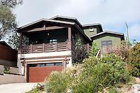 Bennett Residence--new construction two story over garage. Lush, Japanese inspired landscape. Laurie Fisher, architect.