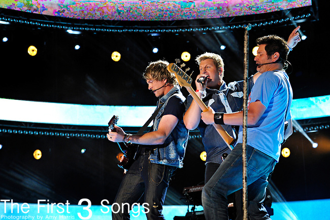 Joe Don Rooney, Gary LeVox, and Jay DeMarcus of Racal Flatts perform at LP Field during the 2012 CMA Music Festival on June 10, 2011 in Nashville, Tennessee.