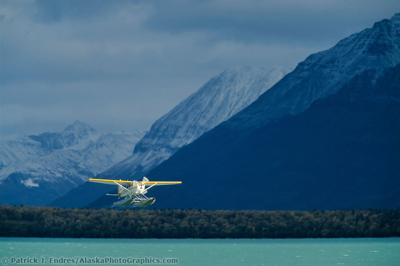 Bush plane on floats takes off from Naknek lake, Katmai National park, Alaska
