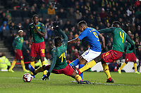 Gabriel Jesus of Brazil and Manchester City gets in a shot past Georges Mandjeck of Cameroon and Maccabi Haifa during Brazil vs Cameroon, International Friendly Match Football at stadium:mk on 20th November 2018
