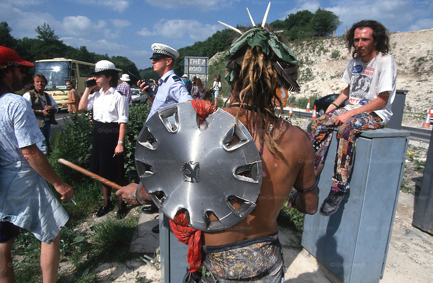 Donga tribe with Vauxhall hub cap shield. Mass trespass. Road Protest actions at Twyford Down, near the Donga pathways, outside Winchester, against the M3 road extension. Summer 1993<br />
