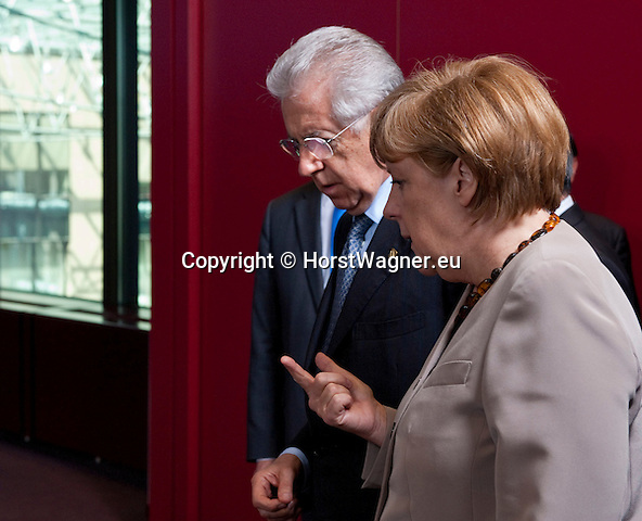 Brussels-Belgium - June 28, 2012 -- European Council, EU-summit meeting of Heads of State / Government; here, get-together for a family picture, Mario MONTI (le), Prime Minister of Italy, with Angela MERKEL (ri), Federal Chancellor of Germany -- Photo: © HorstWagner.eu