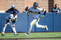 Michigan Wolverines third baseman Jake Bivens (18) rounds third base heading home against the Central Michigan Chippewas on March 29, 2016 at Ray Fisher Stadium in Ann Arbor, Michigan. Michigan defeated Central Michigan 9-7. (Andrew Woolley/Four Seam Images)