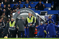 Manchester United Manager, Jose Mourinho, waits at the players tunnel to shake hands with Antonio Conte at the end of the match, but the Chelsea Manager was too busy celebrating on the pitch during Chelsea vs Manchester United, Premier League Football at Stamford Bridge on 5th November 2017