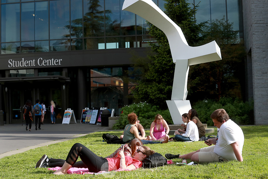 May 10th 2017 - Seattle University students enjoy the warm Spring weather outside the Student Center on campus.