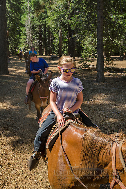 Tourists on guided horseback riding tour at Camp Richardson, near South Lake Tahoe, El Dorado County, California