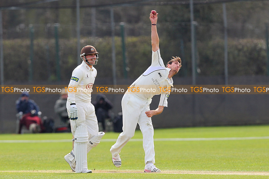 Steven Finn in bowling action for Middlesex as Rory Burns looks on - Middlesex CCC vs Surrey CCC - Pre-Season Friendly Cricket Match at Merchant Taylors School, Sandy Lodge, Northwood - 20/03/14 - MANDATORY CREDIT: Gavin Ellis/TGSPHOTO - Self billing applies where appropriate - 0845 094 6026 - contact@tgsphoto.co.uk - NO UNPAID USE