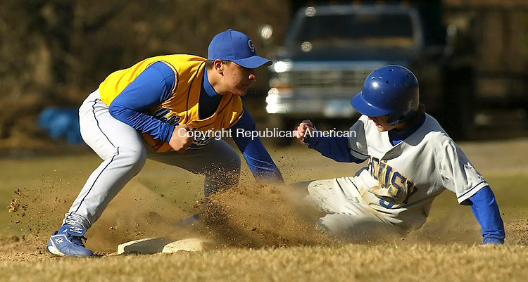 WINSTED, CT 4/9/07- 040907BZ13- Gilbert's Nate LaPointe (2) tags Housatonic's Peter O'Reilly (9) for the out at second during Monday's game.<br /> Jamison C. Bazinet Republican-American