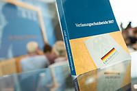 """Bundesinnenminister Horst Seehofer (CSU) und  der Praesident des Bundesamt fuer Verfassungsschutz (BfV), Hans-Georg Maassen stellten am Dienstag den 24. Juli 2018 in Berlin den """"Verfassungsschutzbericht 2017"""" vor.<br /> In dem Bericht werden die Erkenntnisse des BfV zu """"verfassungsfeindlichen Bestrebungen"""" zusammenfasst. Dazu gehoeren Zahlen zur """"Politisch Motivierten Kriminalitaet"""", wie zum Beispiel rechtsextremistische Straftaten. Enthalten sind auch Statistiken und Analysen zu Gruppen, die als militant islamistisch eingestuft werden. Der Termin wurde mehrfach verschoben.<br /> Im Bild: Ein Exemplar des Berichtes.<br /> 24.7.2018, Berlin<br /> Copyright: Christian-Ditsch.de<br /> [Inhaltsveraendernde Manipulation des Fotos nur nach ausdruecklicher Genehmigung des Fotografen. Vereinbarungen ueber Abtretung von Persoenlichkeitsrechten/Model Release der abgebildeten Person/Personen liegen nicht vor. NO MODEL RELEASE! Nur fuer Redaktionelle Zwecke. Don't publish without copyright Christian-Ditsch.de, Veroeffentlichung nur mit Fotografennennung, sowie gegen Honorar, MwSt. und Beleg. Konto: I N G - D i B a, IBAN DE58500105175400192269, BIC INGDDEFFXXX, Kontakt: post@christian-ditsch.de<br /> Bei der Bearbeitung der Dateiinformationen darf die Urheberkennzeichnung in den EXIF- und  IPTC-Daten nicht entfernt werden, diese sind in digitalen Medien nach §95c UrhG rechtlich geschuetzt. Der Urhebervermerk wird gemaess §13 UrhG verlangt.]"""