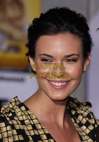 "ODETTE YUSTMAN .""When In Rome"" Los Angeles Premiere - Arrivals held at The El Capitan Theater, Hollywood, CA, USA, .27th January 2010..portrait headshot smiling gold beige black print pattern hair up .CAP/ADM/CH.©Charles Harris/AdMedia/Capital Pictures"