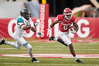 Hawgs Illustrated/BEN GOFF <br /> T.J. Hammonds (right), Arkansas running back, breaks past Kerron Johnson, Coastal Carolina linebacker, in the third quarter Saturday, Nov. 4, 2017, at Reynolds Razorback Stadium in Fayetteville.