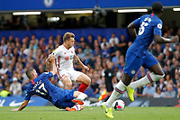 Mateo Kovačić of Chelsea tackles Luke Freeman of Sheffield United during the Premier League match between Chelsea and Sheff United at Stamford Bridge, London, England on 31 August 2019. Photo by Carlton Myrie / PRiME Media Images.