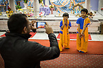 © Joel Goodman . 18 May 2013 . Gita Bhavan Hindu Temple , Withington Road , Whalley Range , Manchester . L-R Dad Aloke and sons Hari (four) , Sami (six) - father is on 07958 643853 wouldn't give surname but said to call if info wanted . Commemorative service to celebrate the handover of the Green Kumbh Yatra (green journey pot or environmental pilgrimage) at the Gita Bhavan Hindu Temple in Manchester . The pot has travelled to the Maha Kumbh Mela , Kenya , Nepal and the Western Wall in Jerusalem along the way . At every place of rest an environmental action must be taken to reflect the pot's environmental significance . It's due to travel to Leicester and feature in an outdoor procession in London on 24th May 2013 . Photo credit : Joel Goodman