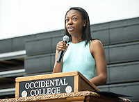 Jessica Maxwell '06, visiting assistant professor of modern and contemporary art, UC Berkeley, gives the Class Day address at Senior Brunch and Class Day, May 16, 2014 in Rush Gym. (Photo by Marc Campos, Occidental College Photographer)