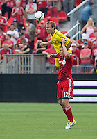 July 27, 2013: Toronto FC forward Justin Braun #17 and Columbus Crew defender Chad Marshall #14 in action during an MLS regular season game between the Columbus Crew and Toronto FC at BMO Field in Toronto, Ontario Canada.