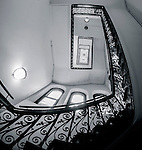 Looking up the staircase at the Lands Department Building in Sydney, NSW, Australia. The tower features a copper onion-shaped dome.<br /> <br /> Architect: James Barnet.