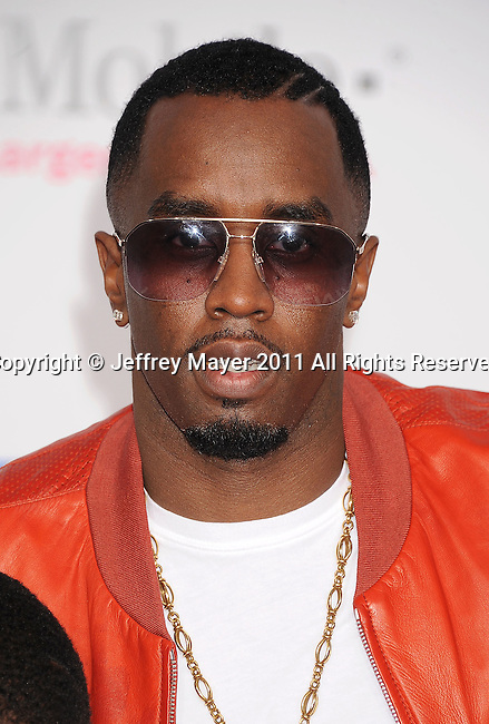 LOS ANGELES, CA - FEBRUARY 20: Sean 'P. Diddy' Combs arrives at the T-Mobile Magenta Carpet at the 2011 NBA All-Star Game at L.A. Live on February 20, 2011 in Los Angeles, California.