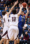 SIOUX FALLS, SD - MARCH 21:  Caden Skinner #14 from St. Thomas More tries to shoot over the double team of Jacob Leighton #24 and Trae VandeBerg #10 from Madison in the second half of their Class A Boys semifinal game Friday evening at the Sioux Falls Arena. (Photo by Dave Eggen/Inertia)