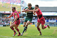 Jamie Gibson of Leicester Tigers takes on the London Welsh defence. Aviva Premiership match, between Leicester Tigers and London Welsh on April 25, 2015 at Welford Road in Leicester, England. Photo by: Patrick Khachfe / JMP