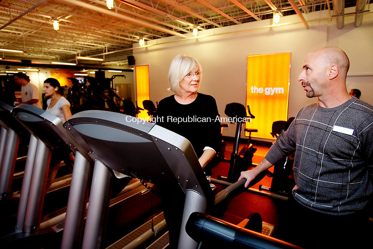 SOUTHBURY, CT 29 October 2008-102908SV06--From left, Anne Marie McCabe of Southbury talks with Jerry Mechamkin, general manager, at The Gym in Southbury Wednesday. Steven Valenti Republican-American