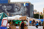 """Protest camp at Placa de Catalunya, Barcelona, Spain. Behind is a Hyundai advertisement, which reads """"Still believe that animals do not love? Another way of thinking is possible"""". The square has been relatively quiet since police attacked and beat protestors on May 27 2011."""