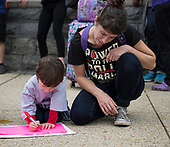 Alex Dodds, right, of Washington, DC looks on as her son creates his own protest sign at the anti-Kavanagh protests outside the the United States Supreme Court in Washington, DC as the US Senators continue their floor statements across the street inside the US Capitol on Saturday, October 6, 2018. <br /> Credit: Ron Sachs / CNP<br /> RESTRICTION: NO New York or New Jersey Newspapers or newspapers within a 75 mile radius of New York City)