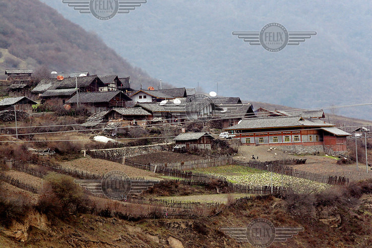 Satellite dishes on the roofs of houses in the Baima village of Paxijia. The Baima people are a minority tribal group of some 1400 people who have become involved in eco-tourism because their ancestral homelands are shared with the giant panda.