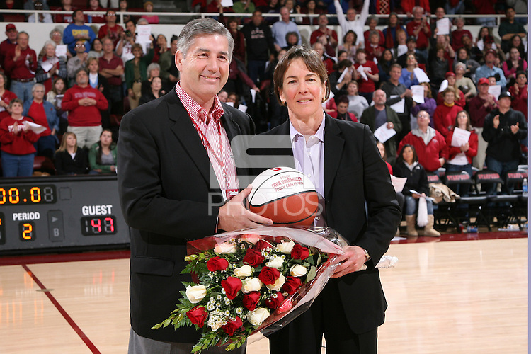 28 December 2007: Bob Bowlsby presents Tara Vanderveer with a basketball and flowers commemorating her 700th career win after Stanford's 105-47 win over Washington State at Maples Pavilion in Stanford, CA.