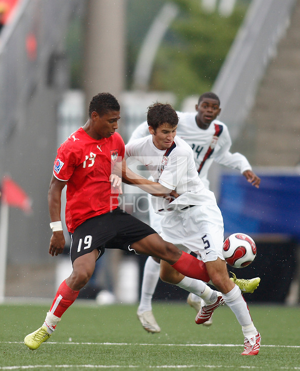 Austria forward (19) Rubin Okotie plays the ball between the legs of USA defender (5) Nathan Sturgis. Austria (AUT) defeated the United States (USA) 2-1 in overtime of a FIFA U-20 World Cup quarter-final match at the National Soccer Stadium at Exhibition Place, Toronto, Ontario, Canada, on July 14, 2007.