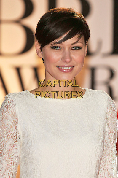EMMA WILLIS .The BRIT Awards 2011 - Arrivals at the O2 Arena, London, England, UK, .February 15th, 2011..brits portrait headshot griffiths white cream lace .CAP/PL.©Phil Loftus/Capital Pictures.