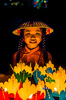 Girl holding paper lanterns, Hoi An Full moon lantern festival, Hoi An, central Vietnam.